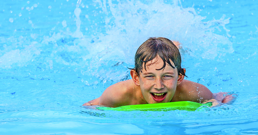 young-boy-swimming-in-pool