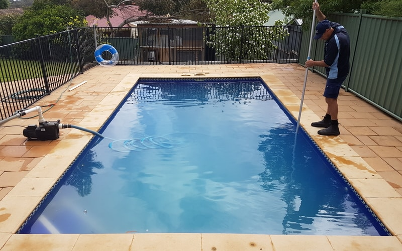 man-cleaning-pool