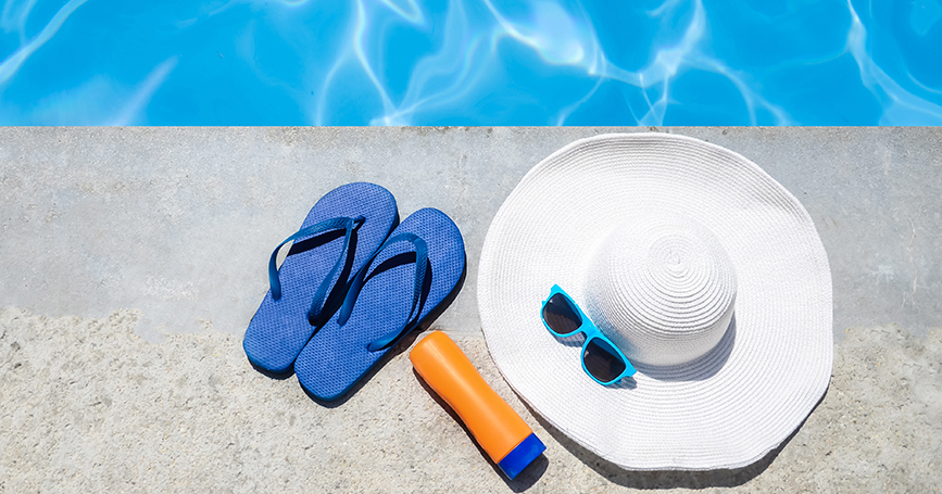 hat-sunscreen-sunglasses-by-pool