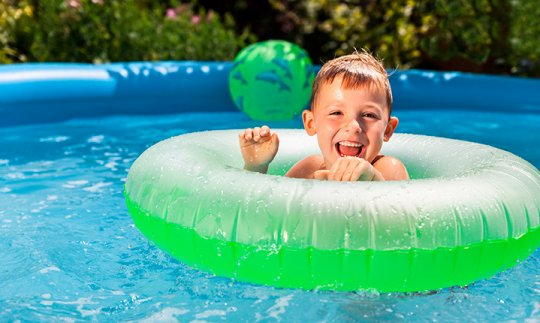 Young boy swimming in tube