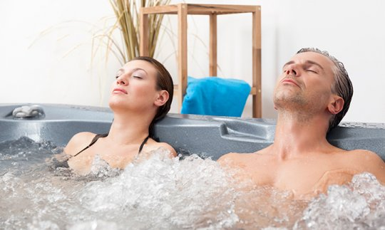 Man and woman relaxing in spa